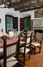Cuban tile floor, shuttered windows, massive stone fireplace