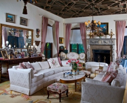 Architectural features include the stenciled ceiling and stone mantel.