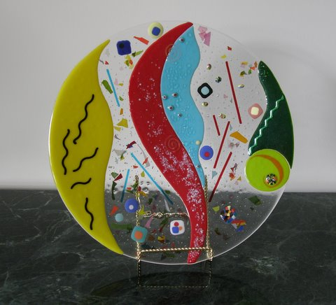 """""""Party,"""" a 19-inch round, fused-glass is $850."""